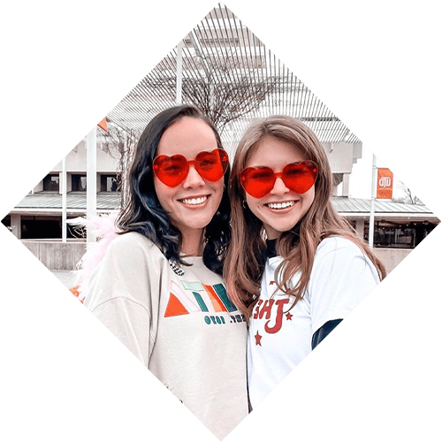 Two Women with red heart-shaped glasses.